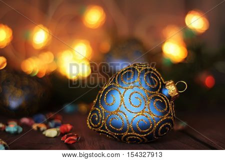 Bright christmas composition with heart bauble and bokeh light