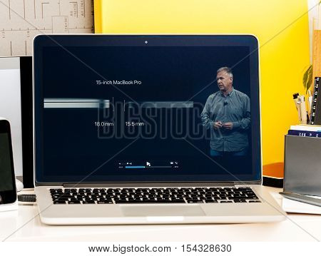 PARIS FRANCE - OCT 28 2016: Apple Computers website on new MacBook Pro Retina with OLED Touch bar in geek creative room showcasing Apple Keynote presentation of Philip Schiller talking about the changes of the new laptop