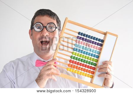 Happy Geeky Man Accountant Calculating With Wooden Numerator Abacus