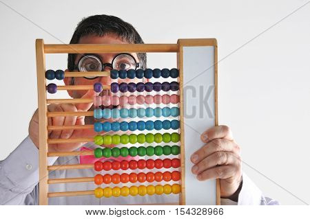 Frustrated Geeky Man Accountant Calculating With Wooden Numerator Abacus