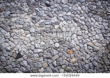 Texture and background of granite stone wall surface.