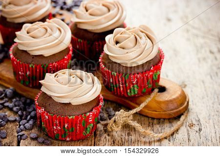 Christmas food - chocolate cupcakes decorated with cream cheese rose