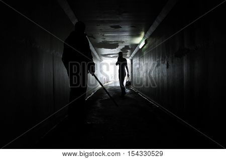 Man Harassing A Woman In A Dark Tunnel