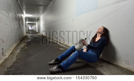 Drunk Woman Drinks Alcohol In A Tunnel