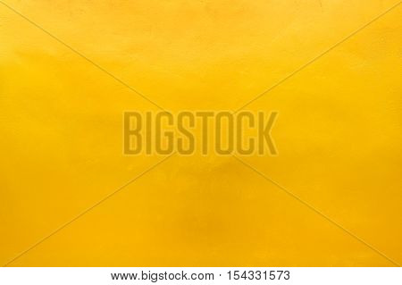 Background and texture of gold or yellow wall.