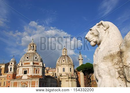 View of the Trajan's Forum twin churches dedicated to Virgin Mary from Altar of Nation monument with renaissance and baroque domes in front of ancient victory column