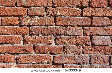 Damaged red brick wall background in Venice