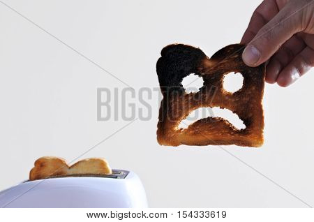 Hand Holds One Slices Of Burnt Toast