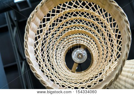 Abstract close up from bottom of weave lamp Asian style hanging on ceiling : show texture of weave