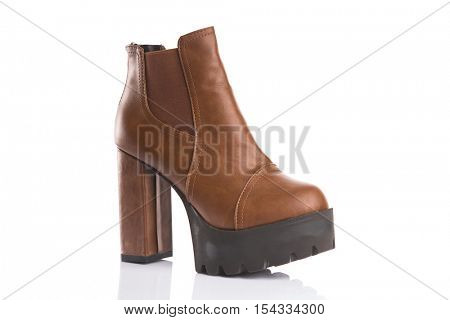 Brown chunky heel boot, isolated on white background