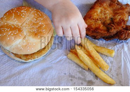 Hand Of A Little Girl Ready To Eat Fast Food