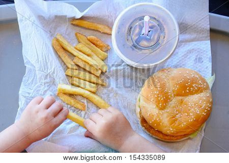 Above View Of Little Girl Ready To Eat Fast Food