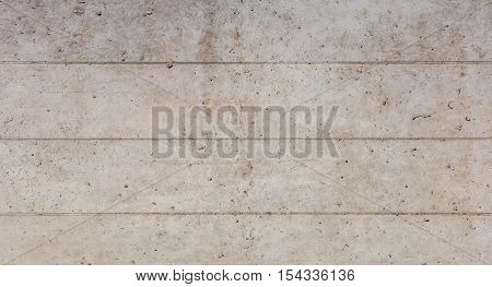 Concrete wall with traces of formwork molding background/texture.