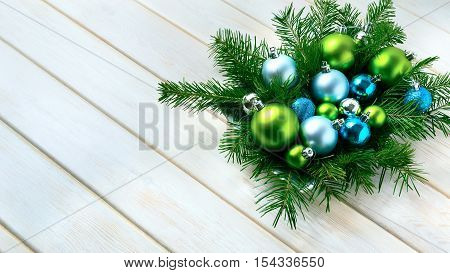 Christmas dinner table centerpiece with blue glitter ornaments. Christmas party decoration with shiny balls. Christmas greeting background. Copy space.