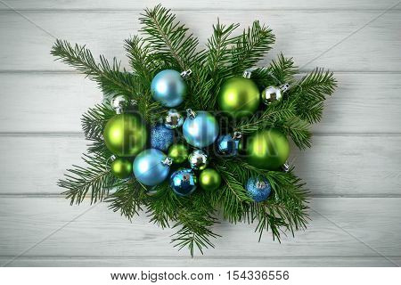 Christmas table centerpiece with blue and green ornaments toned. Christmas party decoration with shiny balls. Christmas greeting background.