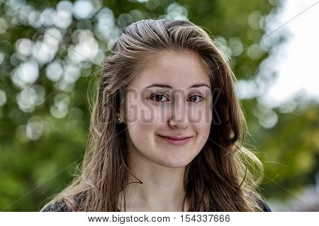 Head Shot of Young woman happily smiling