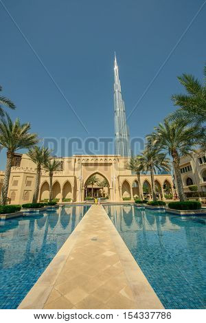 DUBAI, UAE - OCTOBER 11, 2016: The entrance to the Palace Hotel in Dubai with Burj Khalifa in the background. The Burj Khalifa is the tallest structure in the world housing hotels and apartments