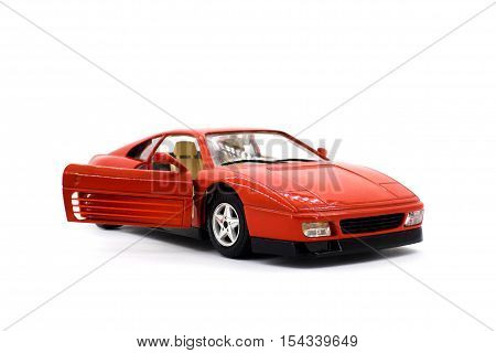 Model of red sports car on a white background closeup