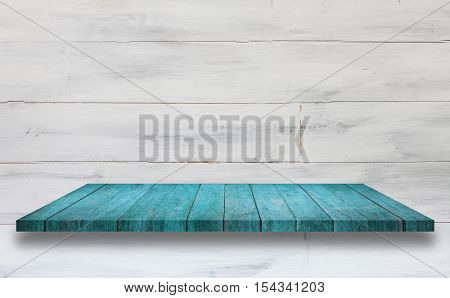 Top of blue wooden shelf with white wooden wall background. For product display