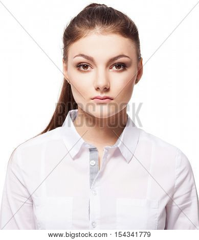 Woman at white background. Young serious woman isolated on white