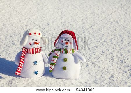 Snowman on snow. Winter wiht snowflake