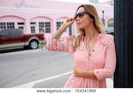 Woman walking through streets of Miami, USA