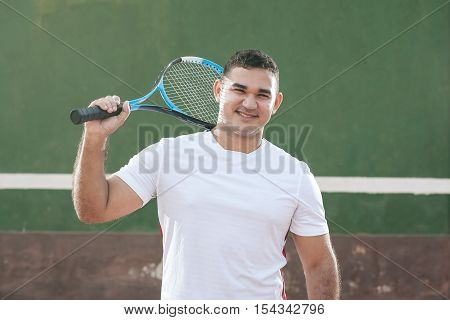 Handsome Young Man On Tennis Court. Man Playing Tennis.