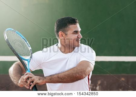 Handsome Young Man On Tennis Court. Man Playing Tennis. Man Is Ready To Hit Tennis Ball