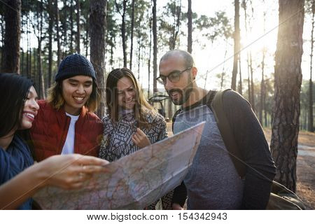Friends Checking Map Outdoors Concept