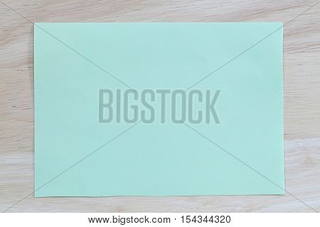 Green notepad paper of empty and copy space on wooden backgroundYou can input the message text in picture.