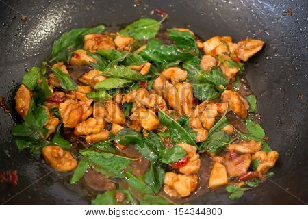 Stir Fried Basil Chicken in the wok, Thai Famous Food, Thai Street Food, Thai Cuisine, Thai Spicy Food