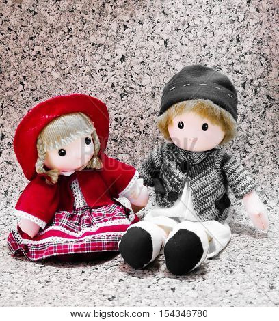Lovely dolls boy and girl background. Christmas dolls decoration. Cute boy and girl dolls
