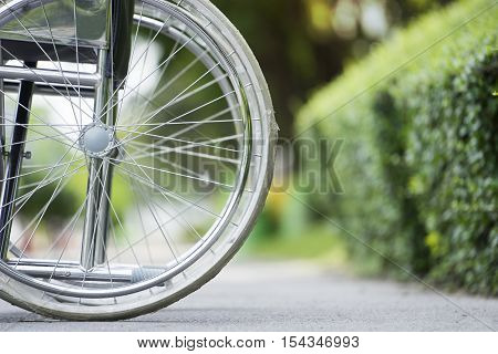 Empty wheelchair parked in park, close up