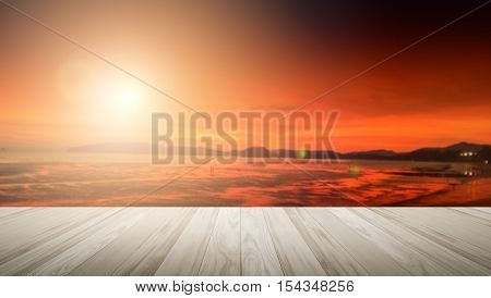 Wood terrace with the blurred background concept.warm colors and bright sun light. bokeh or Summer background.design flare sunlight white sunny sky patterns water beautiful evening clouds.