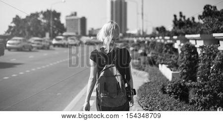 Women Walking Streetside Caucasian Camrea Traveler Concept