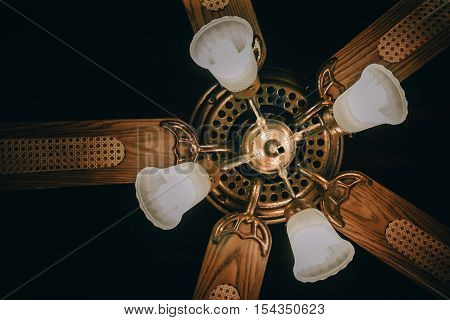 Ceiling fan with lights. Decorative ventilation with lamps on the ceiling. soft focus