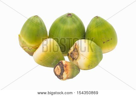 six unripe coconuts on isolated white background