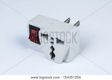 the used plug socket adapter on white background
