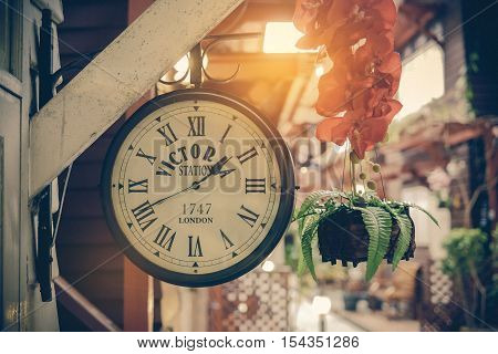 classic clock in the old town background
