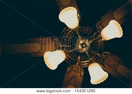 Ceiling fan with lights. Decorative ventilation with lamps on the ceiling. vintage filter with soft focus