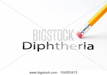 Closeup of pencil eraser and black diphtheria text. Diphtheria. Pencil with eraser.