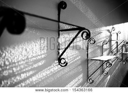 Bizarre glare and shadows cast by an antique black and white abstract photo.