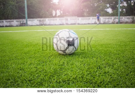 Old Football On Artificial Turf Football Field Green