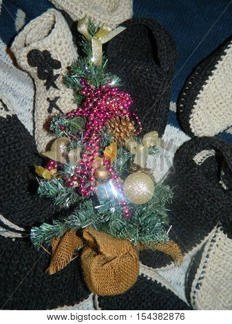 Green artificial Christmas tree with gift socks St. Nicholas, will come the Christmas and new year holidays