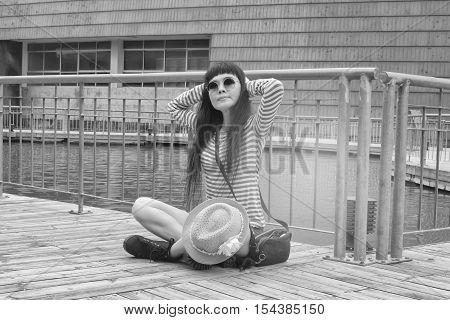 Woman sitting dismal black and white tone