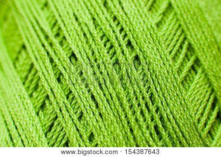 Green knitting thread texture, handiwork backdrop. Bright handiwork background, crochet iris string, Leisure, hobby, needlework concept