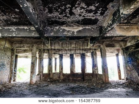 Abandoned burned out building. View from inside, interior