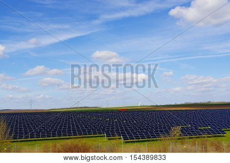 a fiald with solar photovoltaic panels photovoltaic