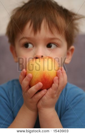 Apple In Hands Of The Child