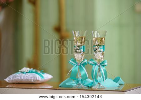 wedding stemware with champagne on wooden glossy table